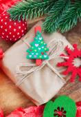 Christmas gift with holiday decorations around — Stock Photo