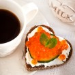 Romantic breakfast-toasts  with red caviar and coffee — Stock Photo #63526357