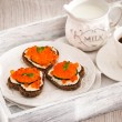 Romantic breakfast-toasts  with red caviar and coffee — Stock Photo #63526359