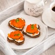 Romantic breakfast-toasts  with red caviar and coffee — Stock Photo #63526363