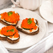 Romantic breakfast-toasts  with red caviar and coffee — Stock Photo #63526371