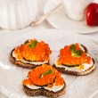 Romantic breakfast-toasts  with red caviar and coffee — Stock Photo #63694427