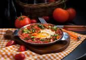 Shakshuka with tomatoes and eggs — Stock Photo
