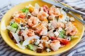 Fresh shrimps, eggs, croutons and vegetables salad — Stock Photo