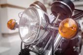 Close up of a motorcycle headlight with blinker light — Stock Photo