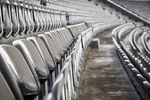 Some rows of gray stadium seats, shoot from the side — Stock Photo
