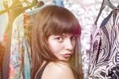 Perky teenage girl and her wardrobe, toned image, bokeh, light l — Stock Photo