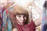 Beautiful teenage girl try a dress, with bokeh, backlit and ligh — Stockfoto