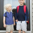 Little Child Looking Up to Big Brother on First Day of School — Stock Photo #51849123