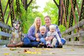 Portrait of Happy Family and Dog Outside in Fall — Stock Photo