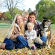 Happy Family and Pet Dog Autumn Portrait — Stock Photo #56431659