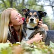 Woman Relaxing with her German Shepherd Dog on Fall Day — Stock Photo #56431845