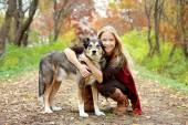 Woman and Dog in Woods in Autumn — Stock Photo