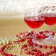 Red Wine Glasses and Bead Decorations in with Gold Background — Stock Photo #58019309