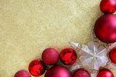 Christmas Bulbs and Star Ornament Frame on Gold Glitter Backgrou — Stock Photo