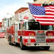 Fire Trucks with American Flags at Small Town Parade — Stock Photo #74931691