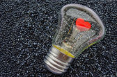 Red heart of an electric bulb — Stock Photo