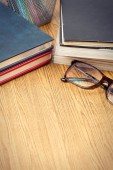 Education book and glasses on wooden table .vignetting style — Stock Photo