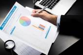 Businessman looking charts and graphs results — Stock Photo