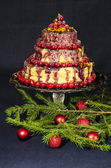 Holiday cake and Christmas tree twigs decorated with balls — Stock Photo