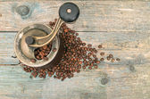 Coffee beans and  grinders on old wooden table — Stock Photo