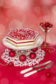 Souffle Cake and Christmas decorations, effeckt bokeh on background. — Stock Photo