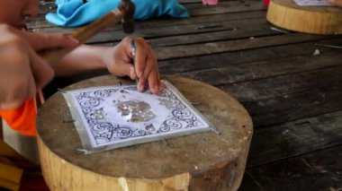 Buddhist novice carving silverware — Stock Video