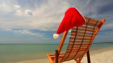 Sunlounger with Santa hat — Stock Video