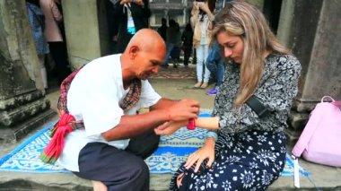 Monk make good luck talisman for tourist — Stock Video