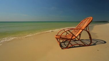 Lounge chair on a beach — Stock Video
