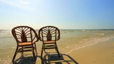 Chairs standing in a water — Vídeo de Stock