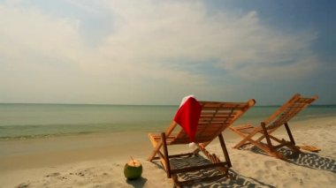 Sunloungers with Santa hat — Stock Video