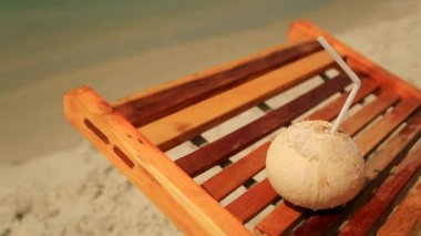 Coconut laying on a sunlounger — Stock Video