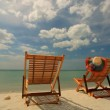 Two sunloungers on tropical beach — Stock Video #62800173