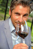 Tourism - Man tasting wine in a castel-Winemaker — Stock Photo