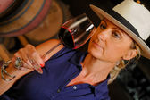 Tourism - Man tasting wine in a cellar-Winemaker — Stock Photo