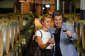 Tourism - Couple tasting wine in a cellar — Stock Photo