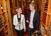 Young couple buying wine in a store — Stock Photo