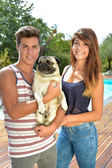 Teenagers wearing a dog — Stock Photo