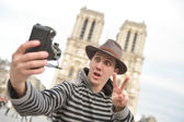 France, Paris, young man taking photograph, Cathedral Notre-Dame — Stock Photo