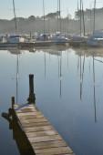 Sailboats Moored on lake at sunrise — Stockfoto