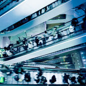 People on crossing Escalators — ストック写真