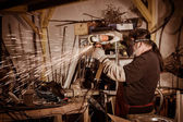 Metal worker Grinding with sparks in workshop — Stock Photo