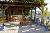 Colorful plants, tables and chairs in a Tavern on Crete — ストック写真
