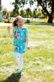 Girl in bright blue floral dress — Foto de Stock