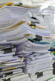 Pile of documents on desk stack up high waiting to be managed — Stock Photo