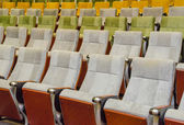 Empty chairs in theatre or conference hall. — Stockfoto