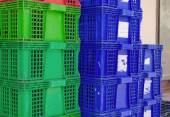 Plastic crate stacked product packing containers — Stock Photo