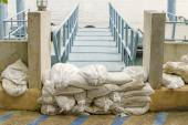 White sandbags for flood defense — Stock Photo