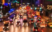 Abstact blur bokeh of Evening traffic jam on road in city — Stock Photo